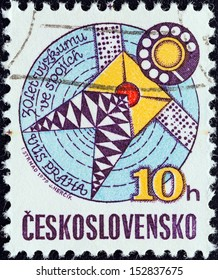 CZECHOSLOVAKIA - CIRCA 1979: A stamp printed in Czechoslovakia issued for the 30th anniversary of Telecommunications Research shows Stylized Satellite, circa 1979.