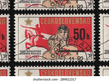 """CZECHOSLOVAKIA - CIRCA 1982: A stamp printed in Czechoslovakia from """"The 65th Anniversary of October Revolution and 60th Anniversary of U.S.S.""""� issue, shows a mounted horse and people with flowers."""