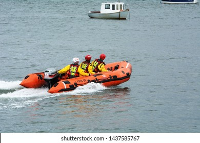 D class inshore lifeboat at Beaumaris lifeboat day on Anglesey in North Wales returning to shore on 2 June 2018