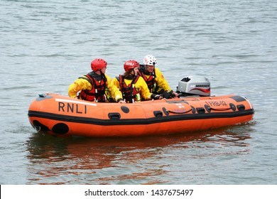 D class inshore lifeboat at Beaumaris lifeboat day on Anglesey in North Wales leaving the shore on 2 June 2018