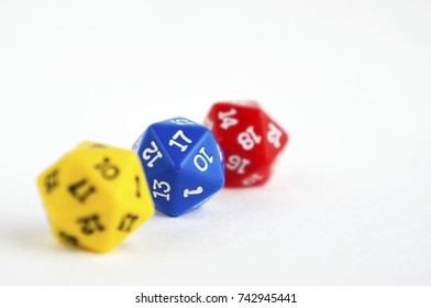 D20 yellow, blue and red dices for rpg, dnd or board games on light background