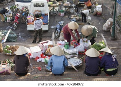 Da Lat city, Vietnam - November 15, 2011: A local farmer and street vendors in sunday market in central city of Da Lat town. These stairs have been built for an age.