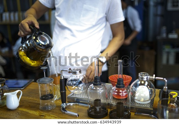 "Da Lat town,Vietnam - April 29 ,2017 :  Barista making coffee. Professional coffee staff doing their work at the ""La Viet"" cafe in Da Lat town, Vietnam"