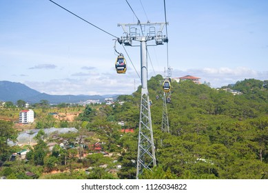 """DA LAT, VIETNAM - DECEMBER 28, 2015: View of the cable car of """"Cap Treo Da Lat"""" in the sunny day."""