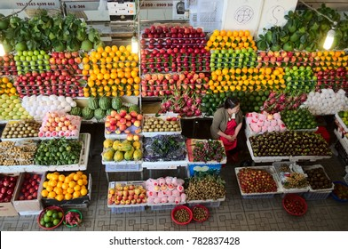 Da Lat, Vietnam - July, 2015: Woman selling large variety of fruits in different colors on the market