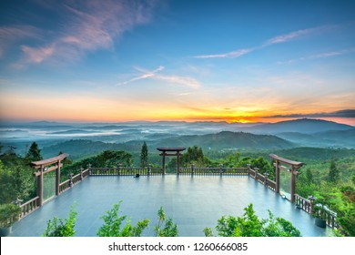 Da Lat, Vietnam - October 30th, 2018: The magical dawn on the pagoda, surrounded by dew and magical light from the beautiful sun to meditate and relax the soul in Da Lat, Vietnam