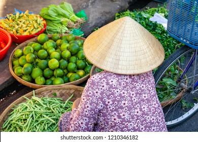 DA LAT, VIETNAM - SEPTEMBER 23: A senior woman sells fruits and vegetables on the street on September 23, 2018 in Da Lat, Vietnam.