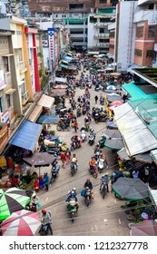DA LAT, VIETNAM - SEPTEMBER 23: View from above to the traffic jam at the Vietnamese street market on September 23, 2018 in Da Lat, Vietnam.