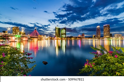 Da Nang city, Vietnam ,10 September 2016 :Reflection sunset in Han River with Flowers and Building.Han River with Sail Bridge Dragon Bridge , Han Bridge... are famous places for visit in Danang.
