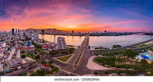 Da Nang city, Vietnam , 27 June 2017:Panorama Da Nang City, Dragon Bridge in the sunrise is very beautiful. Dragon Bridge is Famous Bridge of Da Nang City, the most beautiful travel city in Vietnam.