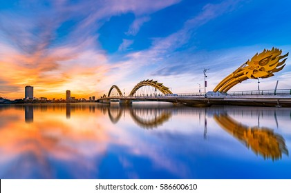 Da Nang city, Vietnam , 28 August 2016: Reflection of Dragon Bridge in the sunrise is very beautiful. Dragon Bridge is Famous Bridge of Da Nang City, the most beautiful travel city in Vietnam.