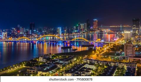 Da Nang city, Vietnam , December 30 2017 : Da Nang city by Night at Han Bridge and Buildings.Han River with Sail Bridge Dragon Bridge , Han Bridge... are famous places for visit in Danang.