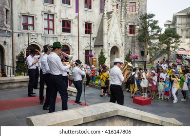 Da Nang, Vietnam - Apr 2, 2016: Street musician group in Ba Na Hills Mountain Resort, the multi-level complex filled with amusement rides, attractions, restaurants, roller skating...