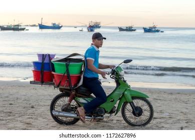 Da Nang, Vietnam - Aug 30, 2018: Morning Fresh local seafood Market and Fisherman bring their coracles onto the seashore in Da Nang, Vietnam.