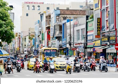 Da Nang, Vietnam - August 19, 2018 : Vietnamese ride motorcycle on the street. Da Nang is the commercial and educational centre of Central Vietnam