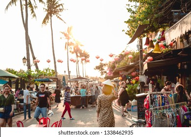Da Nang, Vietnam - February 23, 2019: Tourist woman is wearing Non La (Vietnamese tradition hat) and enjoy sightseeing at Heritage village in Hoi An city in Vietnam.