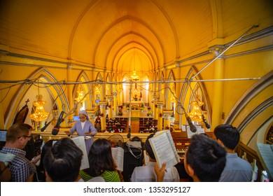 Da Nang, Vietnam - FEBRUARY 27, 2019:  A choir sings during Sunday at the Da Nang Cathedral.