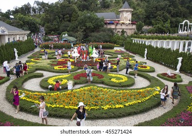 Da Nang, Vietnam - Jun 20, 2016: Tourist visiting a floral garden with many kind of colorful flower in Ba Na Hills mountain resort, Da Nang, Vietnam.