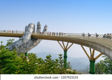 Da Nang, Vietnam - Mar. 29, 2019: The Golden Bridge. The two giant colossal hands emerging from the mountains holding up the golden bridge at the height of 1,414 m from the sea level in BaNa Hills.