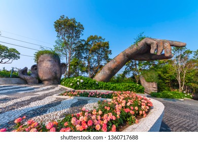 Da Nang, Vietnam - Mar. 29, 2019: Giants sculpture in the garden on Ba Na Hills french village, Ba Na Hills mountain resort is a favorite destination for tourists.