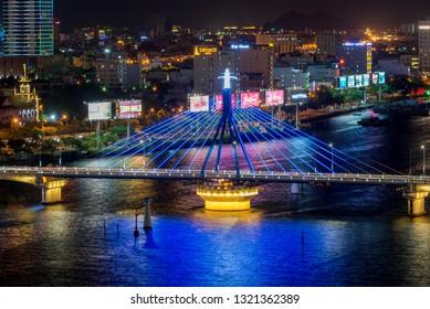 Da Nang, Vietnam - May 24, 2016: Business and Administrative District of Da Nang city on the Han riverbank, with Song Han and Rong Bridge.