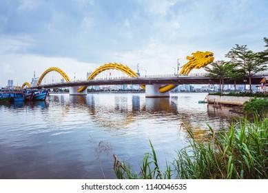 Da Nang, Vietnam - May 7, 2018: Dragon Bridge against the overcast sky, view from an embankment.