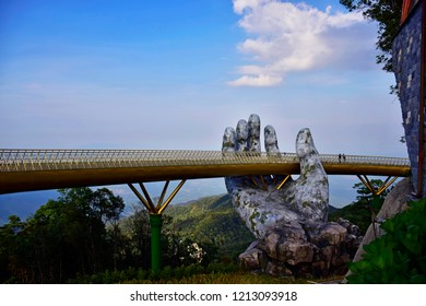 Da Nang, Vietnam -May 7, 2016:The Golden Bridge is lifted by two giant hands,Sun World Ba Na Hills is a resort complex combining entertainment with the highest level in Vietnam traveling on cable line