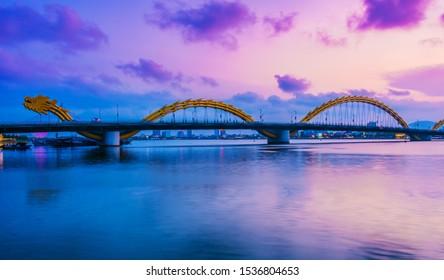 DA NANG, VIETNAM - OCT 4, 2019: Night view of the Dragon Bridge over Han River in Da Nang city in South Central Coast of Vietnam