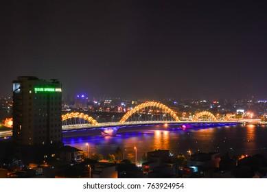 DA NANG, VIETNAM, October 10, 2013 dragon bridge, in Da Nang  Vietnam. At night, Long exposure photograph, with grain.Image contain certain grain or noise and soft focus.