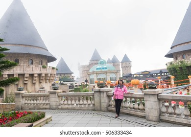 Da Nang, Vietnam - October 24, 2016: Woman Tourist  visiting Ba Na Hills mountain resort. Female tourist takes picture in Bana hill European town style in Vietnam.