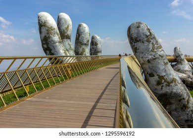 "Da Nang, Vietnam - October 31, 2018: Golden Bridge known as ""Hands of God"", a pedestrian footpath lifted by two giant hands, open in July 2018 at Ba Na Hills in Da Nang, Vietnam."