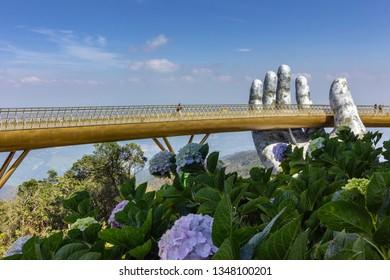 "Da Nang, Vietnam - October 31, 2018: Golden Bridge known as ""Hands of God"", a pedestrian footpath lifted by two giant hands, open in July 2018 at Ba Na Hills in Da Nang, Vietnam."
