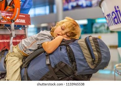 Da Nang, Vietnam. September 25, 2014. The boy is sleeping on a backpack in an Airport.