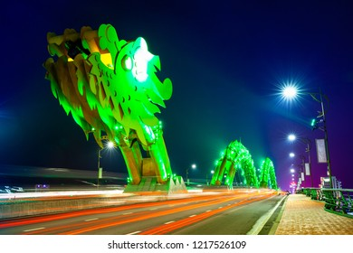 DA NANG, VIETNAM - SEPTEMBER 30: The Dragon Bridge (Cau Rong) with green-colored illumination at night on September 30, 2018 in Da Nang, Vietnam.