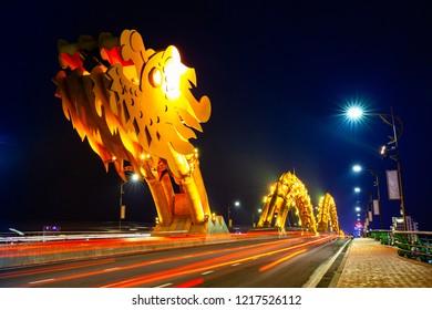 DA NANG, VIETNAM - SEPTEMBER 30: The Dragon Bridge (Cau Rong) with orange-colored illumination at nighton September 30, 2018 in Da Nang, Vietnam.