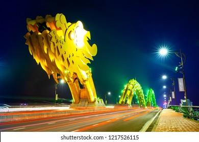 DA NANG, VIETNAM - SEPTEMBER 30: The Dragon Bridge (Cau Rong) with yellow-colored illumination at night on September 30, 2018 in Da Nang, Vietnam.