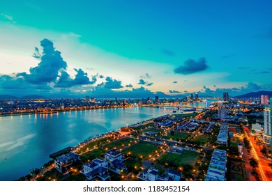 Da Nang, Vietnam: the splendid view of Da Nang city at sunset with many colorful lights.