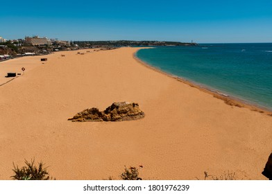 Da Rocha Beach. Great beach located in the town of Portimao. Fine sand beach, turquoise waters. Surrounded by cliffs, huge rocks and caves.
