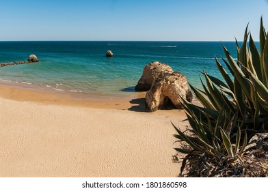 Da Rocha beach. Praia da Rocha is one of the wonders of the Algarve, Portugal, a beach with huge rocks in the water, with cliffs, caves ...