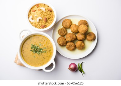 Daal Baati Churma is a popular Healthy food from Rajasthan, India. Served in white crockery over moody background.