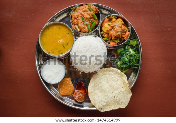 Daal Bhat, Traditional Nepali Food From Directly Above with Curry, Lentils, Yoghurt Curd, Spinach and Rice