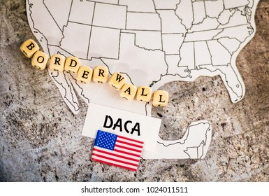 DACA immigration concept on map with border wall spelled out