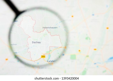 Dachau city in Germany, Bavaria visualization illustrative concept on display screen through magnifying glass