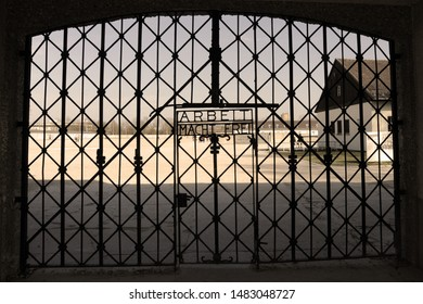 "Dachau concentration camp, the first Nazi concentration camp opened in Nazi Germany. The writing on the gate that says ""labor sets free"""