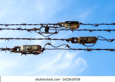 Dachau Concentration camp memorial. Barbed wire. Prison symbol. Dachau, Germany : April 2, 2019 - Immagine