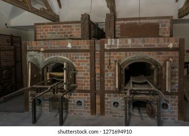 Dachau, Germany, June 27 2018: Looking at crematorium ovens at Dachau Camp