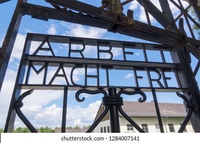 Dachau, Germany, June 27 2018: Focus on Arbeit Macht Frei entrance at Dachau Concentration Camp