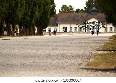 DACHAU, GERMANY - MARCH 14, 2019: Dachau Nazi Concentration Camp lane with trees