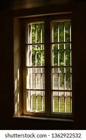 DACHAU, GERMANY - MARCH 14, 2019: Dachau Nazi Concentration Camp window inside prison cell