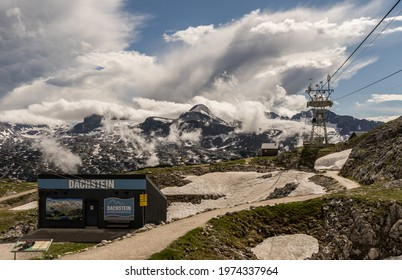 Dachstein, Austria - June 25th, 2020: A spectacular view with sun and dark clouds at the Krippenstein in the Dachstein Mountains